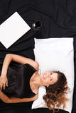 Young woman in the bedroom with a Laptop and a glass of wine stock photos