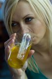 Young woman with beer Stock Images