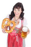 Young woman with beer glass. And bretzel in traditional costume stock photo