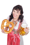 Young woman with beer glass. And bretzel in traditional costume royalty free stock photos