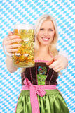 Young woman with beer glass Royalty Free Stock Photography