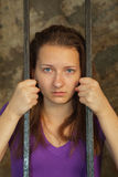 Young woman behind the bars Stock Photography