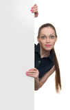 Young woman behind blank white board Royalty Free Stock Photography