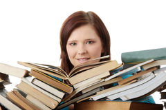 Young woman behind books Royalty Free Stock Image