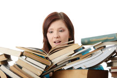 Young woman behind books Royalty Free Stock Photos