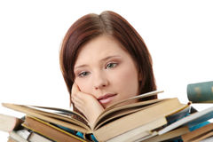 Young woman behind books Stock Photo
