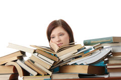 Young woman behind books Royalty Free Stock Photography