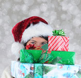 Young Woman Behind Christmas Presents Royalty Free Stock Image
