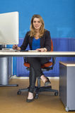 Young woman behind desk royalty free stock images