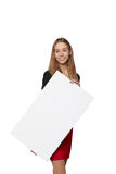 Young woman behind, holding blank advertising board banner, over Stock Photography