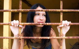 Young woman behind a lattice Stock Photo