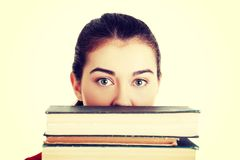 Young woman behind an old books Royalty Free Stock Photos