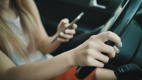 Young woman behind the wheel. stock photography
