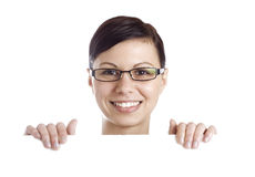 Smiling woman holding billboard Stock Image