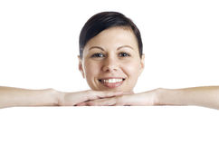 Smiling woman holding billboard Royalty Free Stock Image