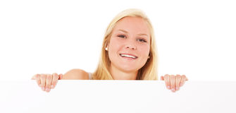 Young woman behind white wall Royalty Free Stock Photo