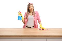 Young woman behind a wooden counter fed up of royalty free stock images