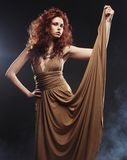 Young woman in beige long dress Stock Photos