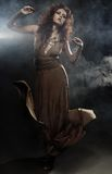Young woman in beige long dress Royalty Free Stock Images