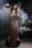 Young woman in beige long dress Royalty Free Stock Photography