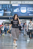 Young woman at Beijing Railway Station South, China royalty free stock photos
