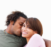 Young woman being kissed by a man Stock Photo