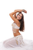 Young woman belly dancer in white costume Royalty Free Stock Images