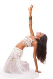 Young woman belly dancer in white costume Stock Photo