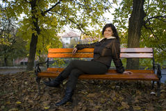 Young woman on a bench Royalty Free Stock Image