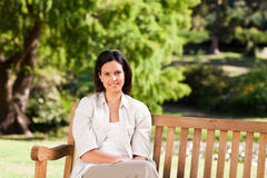Young woman on the bench Royalty Free Stock Photo