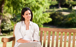 Young woman on the bench Stock Photography