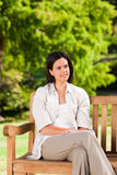 Young woman on the bench Royalty Free Stock Photography