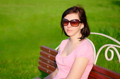 Young woman on a bench Stock Images