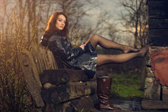 Young woman on a bench royalty free stock photos