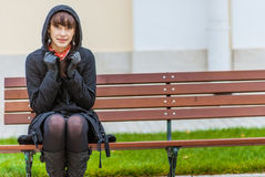 Young woman on bench Stock Photography