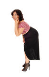 Young woman bending down. Royalty Free Stock Images