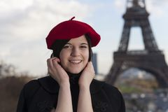 Beret. Young woman with a beret and the eiffel tower Royalty Free Stock Photography