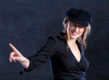 Young woman in beret pointing the finger. Young woman - french style - with beret and glasses, pointing the finger on something Stock Images