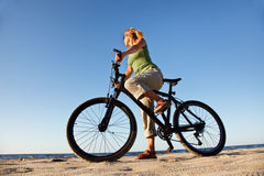 Young woman with bicycle Stock Photos