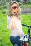 Young woman with bicycle Royalty Free Stock Photography