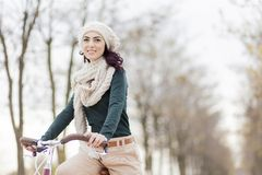 Young woman on the bicycle royalty free stock photo