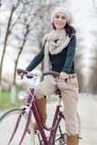 Young woman on the bicycle Royalty Free Stock Images