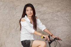 Young woman with bicycle Royalty Free Stock Image