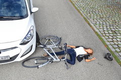 Young woman with Bicycle accident Royalty Free Stock Photos