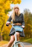 Young woman on bicycle Royalty Free Stock Image