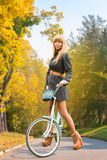 Young woman on bicycle Stock Photos
