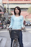 Young Woman on a Bicycle in Beijing Stock Image