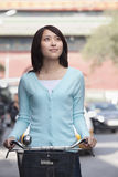 Young Woman on a Bicycle in Beijing Royalty Free Stock Photo