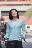 Young Woman on a Bicycle in Beijing Royalty Free Stock Photos