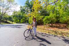 Young woman with a bicycle in the Central park, New York, USA Royalty Free Stock Photography